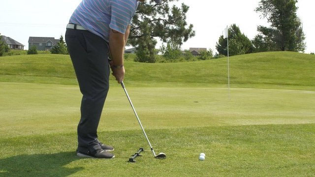 Man chipping with Rimer Ball Position Trainer